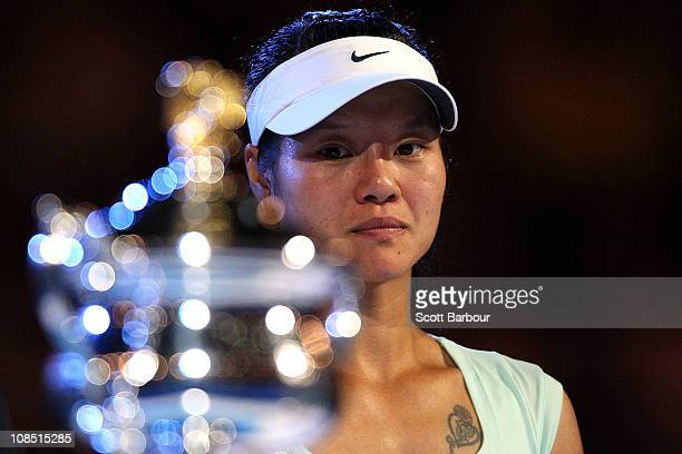 Na Li of China looks on at the Daphne Akhurst Trophy after losing her women's final match against Kim Clijsters of Belgium during day thirteen of the...