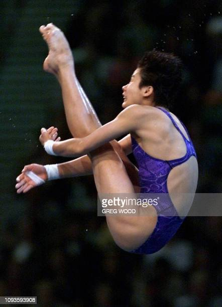 Na Li of China performs during the 10m platform final 24 September 2000 at Sydney international Aquatic centre hosting the diving competition of the...