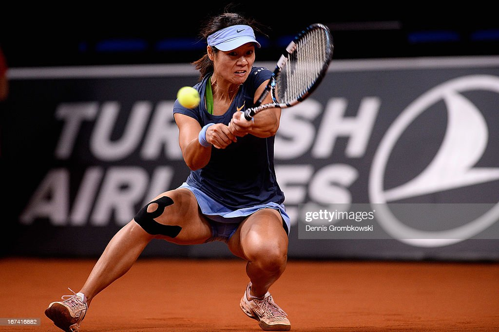 Na Li of China plays a backhand in her match against Mirjana Lucic-Baroni of Croatia during Day 4 of the Porsche Tennis Grand Prix at Porsche-Arena on April 25, 2013 in Stuttgart, Germany.