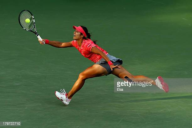Na Li of China plays a forehand during her women's singles semifinal match against Serena Williams of United States of America on Day Twelve of the...