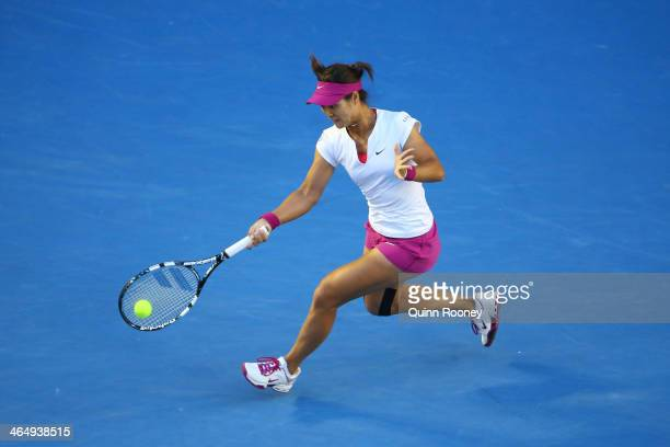 Na Li of China plays a forehand in her women's final match against Dominika Cibulkova of Slovakia during day 13 of the 2014 Australian Open at...