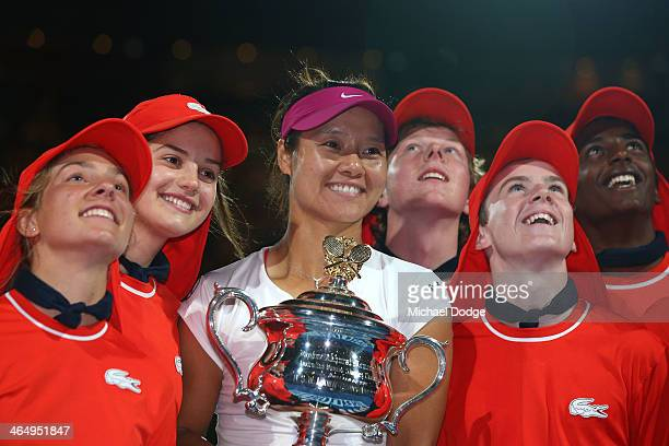 Na Li of China poses with ball kids as she holds the Daphne Akhurst Memorial Cup after winning the women's final match against Dominika Cibulkova of...