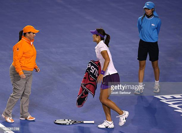Na Li of China requests medical attention after injuring her ankle in her women's final match against Victoria Azarenka of Belarus during day...