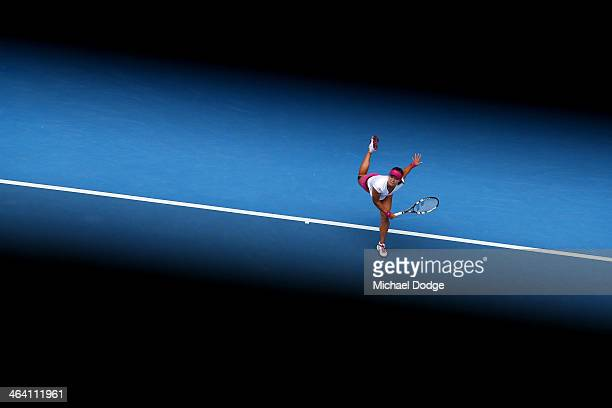 Na Li of China serves in her quarterfinal match against Flavia Pennetta of Italy during day nine of the 2014 Australian Open at Melbourne Park on...
