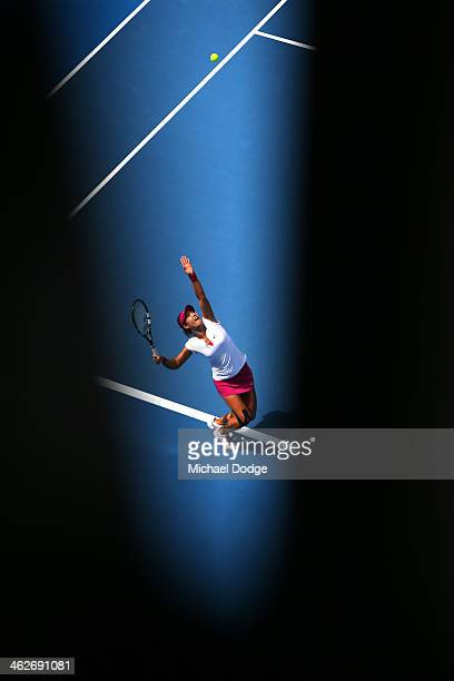 Na Li of China serves in her second round match against Belinda Bencic of Switzerland during day three of the 2014 Australian Open at Melbourne Park...