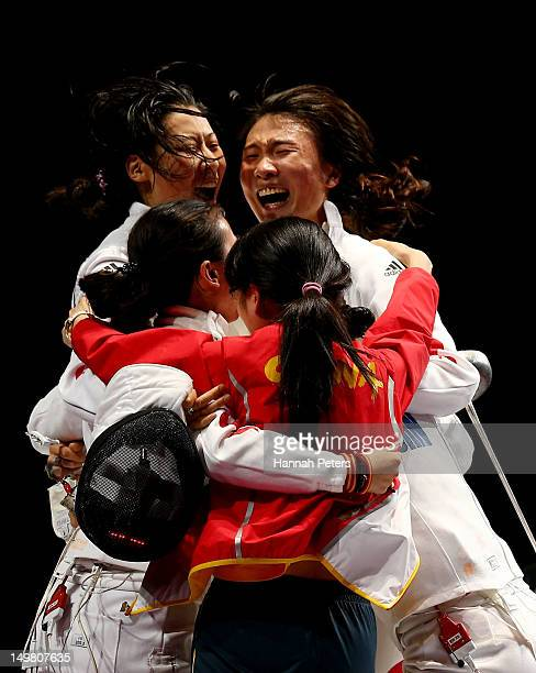 Na Li Xiaojuan Luo Yujie Sun and Anqi Xu of China celebrate their 3925 win over Korea during their Gold Medal Match in the Women's Epee Team Fencing...