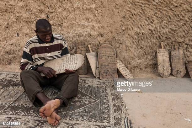 'nA malian man hold the Koran written on wooden tablets in a Koranic school on August 11 2013 in Timbuktu Mali'nIn January 2012 a Tuareg rebellion...