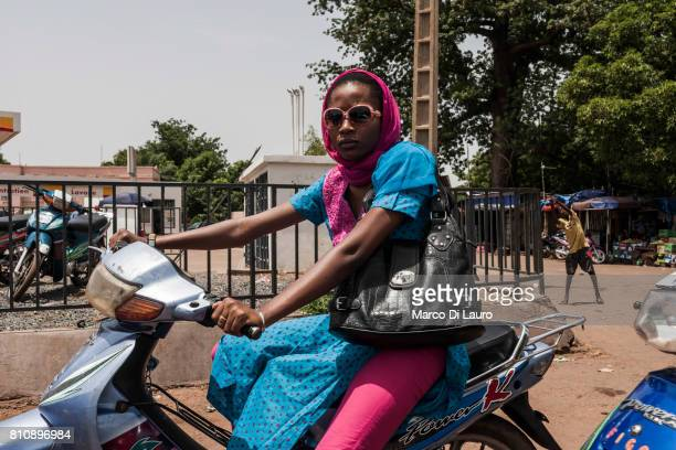 "NA Malian woman is seen riding her scooter in downtown on July 28, 2013 in Bamako, Mali.""nIn January 2012 a Tuareg rebellion began in Northern Mali,..."