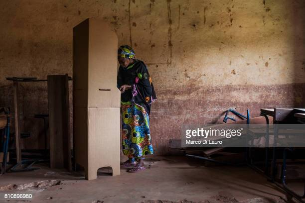 "NA Malian woman is seen voting at the pooling booth during the first round of the Presidential election on July 28, 2013 in Bamako, Mali.""nIn January..."