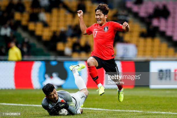 Na Sangho of South Korea competes for the ball with Liu Dianzuo of China during the EAFF E-1 Football Championship match between South Korea and...