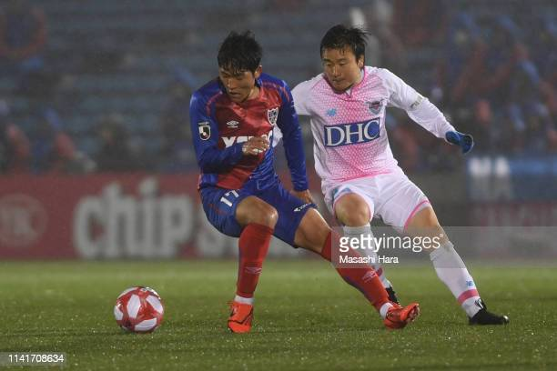 Na Saungho of FC Tokyo and Kazuki Anzai of Sagan Tosu compete for the ball during the J.League Levain Cup Group B match between FC Tokyo and Sagan...