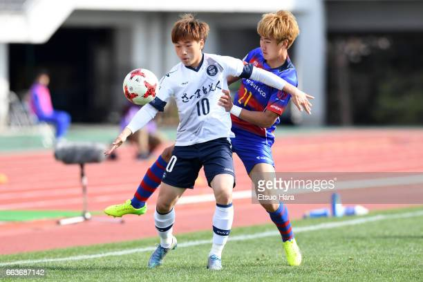 Na Sung Soo of Kagoshima United and Yu In Soo of FC Tokyo U-23 compete for the ball during the J.League J3 match between FC Tokyo U-23 and Kagoshima...