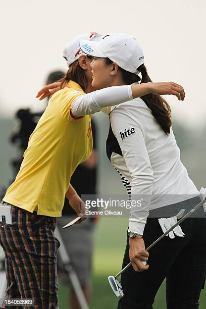 Na Yeon Choi of South Korea and Hee Kyung Seo of South Korea hug at the end of the second round of the Reignwood LPGA Classic at Pine Valley Golf...