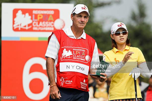 Na Yeon Choi of South Korea discuss the next drive with her caddie during the second round of the Reignwood LPGA Classic at Pine Valley Golf Club on...