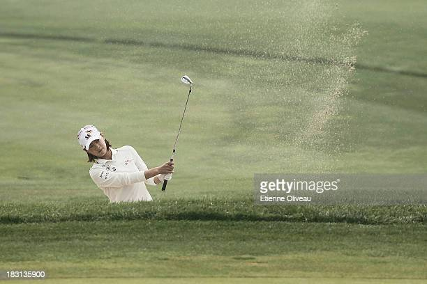 Na Yeon Choi of South Korea hits out of a bunker during the third round of the Reignwood LPGA Classic at Pine Valley Golf Club on October 5 2013 in...