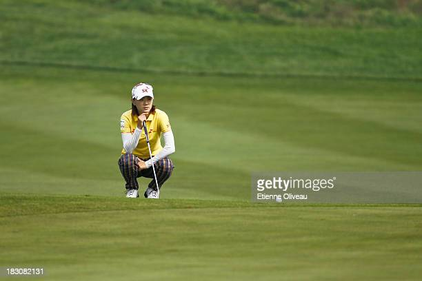 Na Yeon Choi of South Korea lines up a putt during the second round of the Reignwood LPGA Classic at Pine Valley Golf Club on October 4 2013 in...