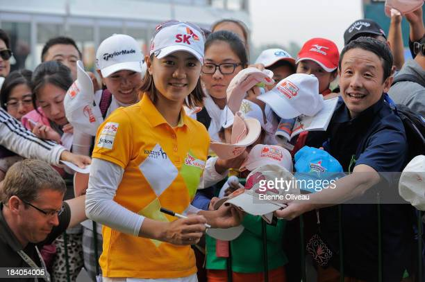 Na Yeon Choi of South Korea poses with golf fans after the first round of the Reignwood LPGA Classic at Pine Valley Golf Club on October 3 2013 in...
