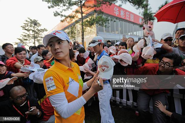 Na Yeon Choi of South Korea signs autographs the first round of the Reignwood LPGA Classic at Pine Valley Golf Club on October 3 2013 in Beijing China