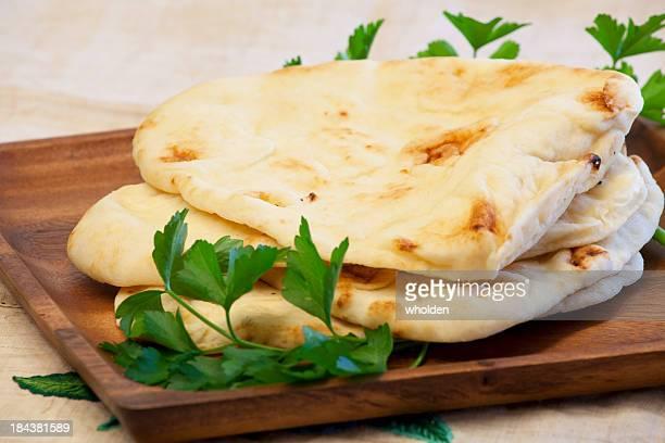 Naan Bread on Wood Platter