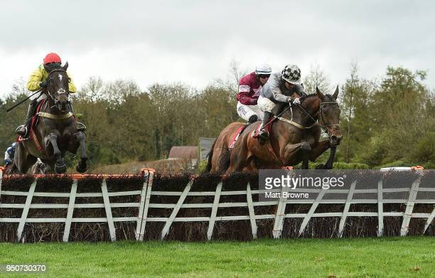 Naas Ireland 24 April 2018 Draconien with Noel Fehily up jump the last on their way to winning The Herald Champion Novice Hurdle from second place...