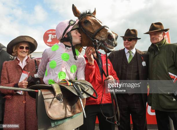 Naas Ireland 26 April 2018 Maureen Mullins along with Rich Ricci second from right and her son Willie Mullins look on as David Mullins kisses...