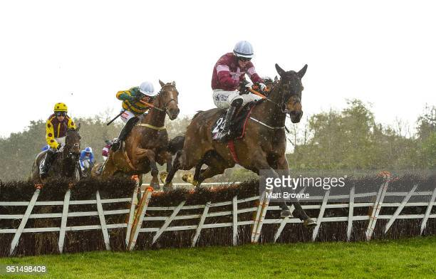 Naas Ireland 26 April 2018 Park Paddocks with Jack Kennedy up jump the last on their way to winning the JLT Handicap Hurdle at Punchestown Racecourse...