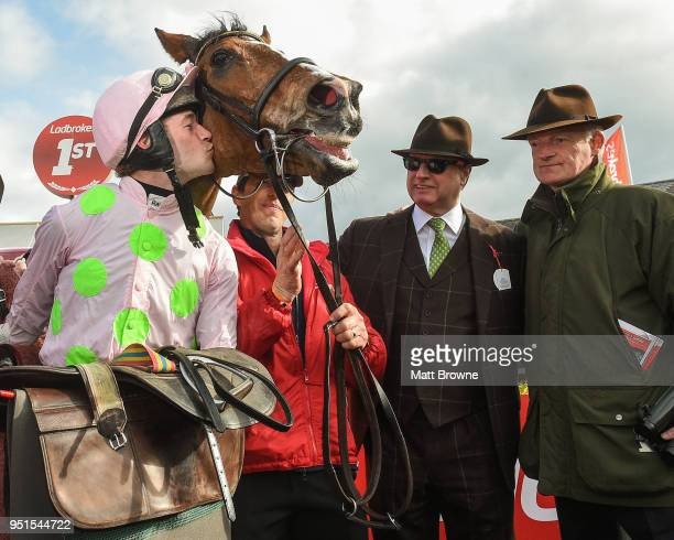 Naas Ireland 26 April 2018 Rich Ricci and Willie Mullins look on as David Mullins kisses Faugheen after winning the Ladbrokes Champion Stayers Hurdle...