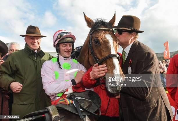 Naas Ireland 26 April 2018 Willie Mullins and jockey David Mullins look on as Owner Rich Ricci kisses Faugheen after winning the Ladbrokes Champion...