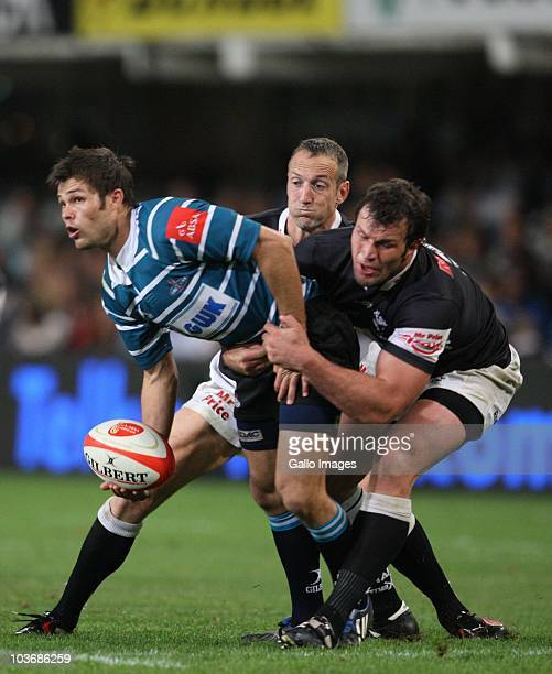 Naas Olivier of Griquas looks to off load as he is tackled by Bismarck Du Plessis during the Absa Currie Cup match between the Sharks and GWK Griquas...