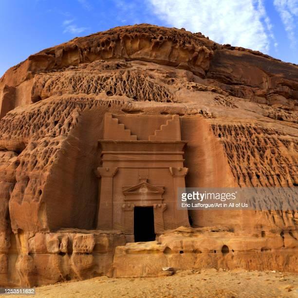 Nabataean tomb in al-Hijr archaeological site in Madain Saleh, Al Madinah Province, Alula, Saudi Arabia on January 25, 2010 in Alula, Saudi Arabia.