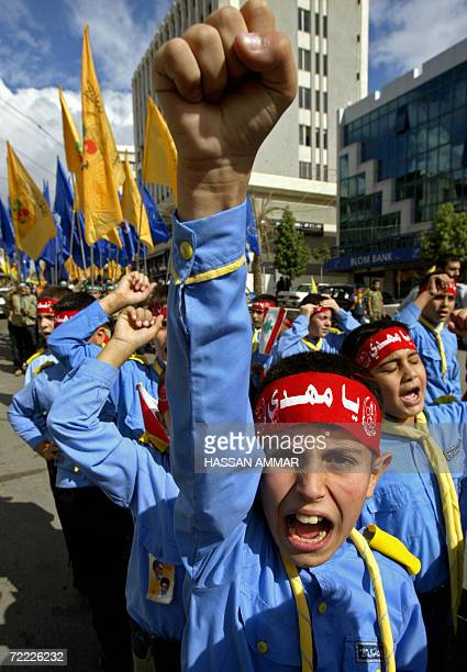 A young boy of Hezbollah's alMehdi scouts chants slogans against Israel during a parade in the Lebanese southern suburb of Nabatiyeh 20 October 2006...