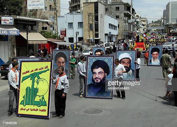 Hezbollah and Lebanese flags and portraits of Iranian and Lebanese Shiite Muslim clerics including Hezbollah leader Hassan Nasrallah are displayed...