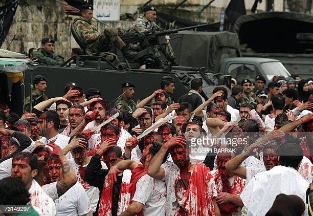 Lebanese Shiite Muslims cut their heads with swords during a religious parade held under tight security in the southern town of Nabatiyeh 30 January...
