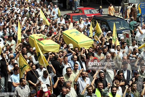 Relatives and comrades of two Hezbollah fighters carry their coffins during their funeral procession in the southern Lebanese town of Nabatiyeh 15...