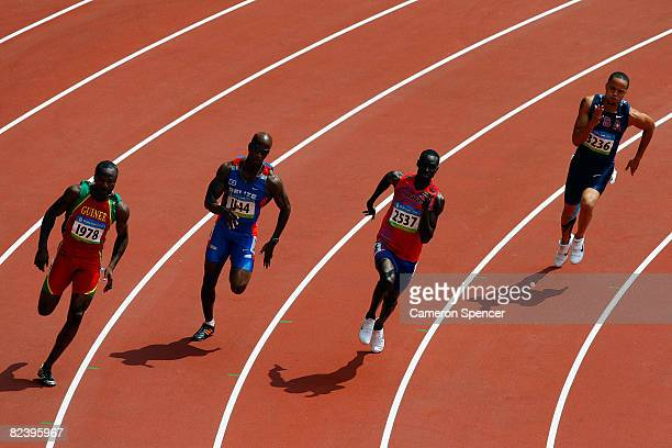 Nabie Foday Fofanah of Guinea Jayson Jones of Belize Jaysuma Saidy Ndure of Norway and Wallace Spearmon of the United States compete in the Men's...