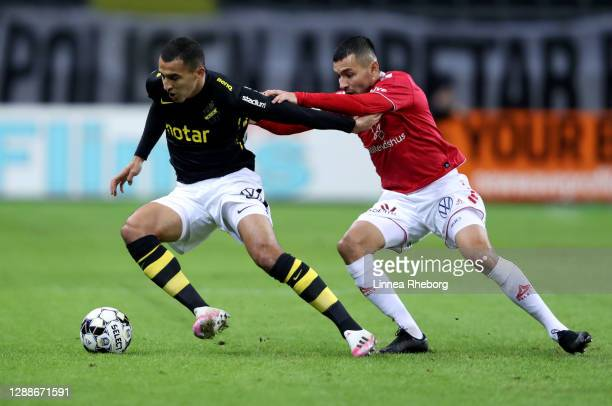 Nabil Bahoui of AIK battles for possession with Emin Nouri of Kalmar FF during the Allsvenskan match between AIK and Kalmar FF at Friends arena on...