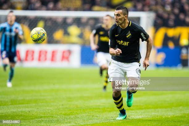 Nabil Bahoui of AIK chases the ball during an Allsvenskan match between AIK and Djurgardens IF at Friends arena on April 15 2018 in Solna Sweden