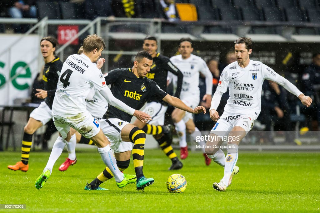 Nabil Bahoui of AIK in a duel with Oscar Pehrsson of IK Sirius during an Allsvenskan match between AIK and IK Sirius at Friends Arena on April 27, 2018 in Solna, Sweden.