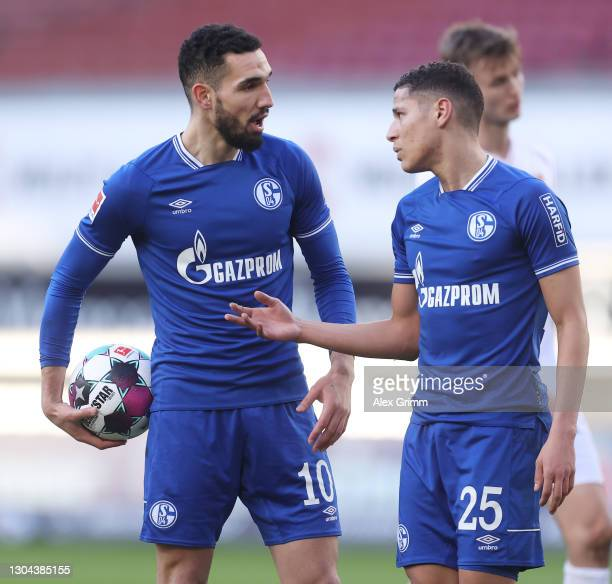 Nabil Bentaleb and Amine Harit of FC Schalke 04 clash over who should take a penalty for FC Schalke 04, before Nabil Bentaleb of FC Schalke 04 goes...