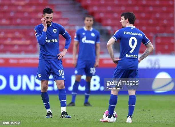 Nabil Bentaleb and Benito Raman of FC Schalke 04 look dejected after conceding a fourth goal during the Bundesliga match between VfB Stuttgart and FC...