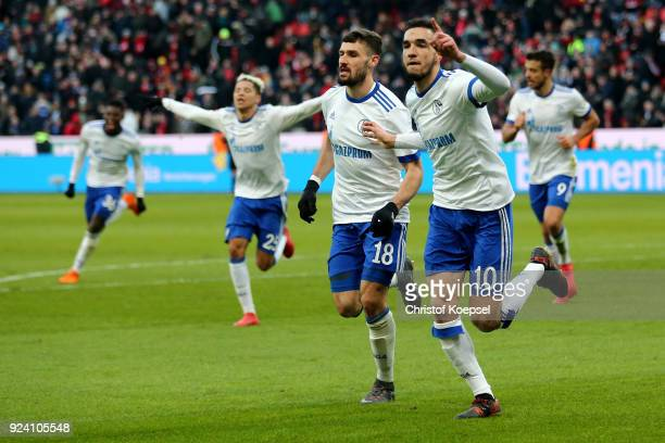 Nabil Bentaleb celebrates the second goal with Daniel Caligiuri of Schalke celebrates the first goal during the Bundesliga match between Bayer 04...