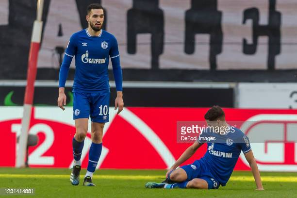Nabil Bentaleb of FC Schalke 04 and Amine Harit of FC Schalke 04 battle for the ball during the Bundesliga match between VfB Stuttgart and FC Schalke...