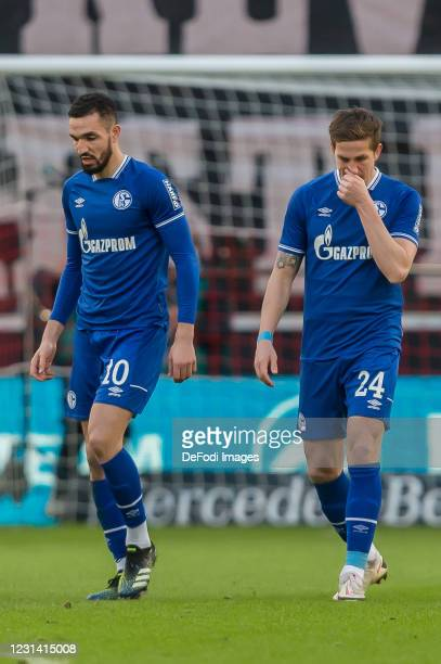 Nabil Bentaleb of FC Schalke 04 and Bastian Oczipka of FC Schalke 04 looks dejected during the Bundesliga match between VfB Stuttgart and FC Schalke...