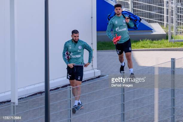 Nabil Bentaleb of FC Schalke 04 and Kerim Calhanoglu of FC Schalke 04 look on during the FC Schalke 04 Training Session on May 03, 2021 in...