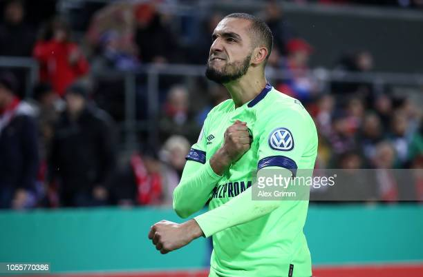 Nabil Bentaleb of FC Schalke 04 celebrates scoring his side's first goal from the penalty spot during the DFB Cup match between 1 FC Koeln and FC...