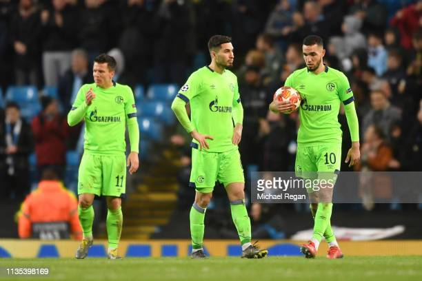 Nabil Bentaleb of FC Schalke 04 collects the ball and reacts after Manchester City score their 6th goal during the UEFA Champions League Round of 16...