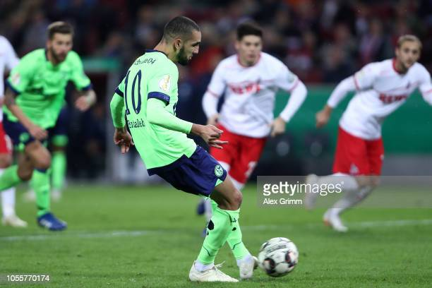 Nabil Bentaleb of FC Schalke 04 scores his side's first goal from the penalty spot during the DFB Cup match between 1 FC Koeln and FC Schalke 04 at...
