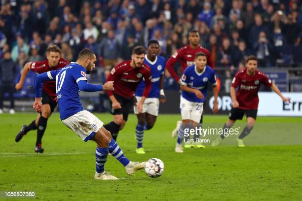 Nabil Bentaleb of FC Schalke 04 scores his team's first goal from the penalty spot during the Bundesliga match between FC Schalke 04 and Hannover 96...