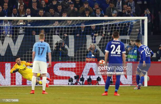 Nabil Bentaleb of FC Schalke 04 scores his team's first goal from the penalty spot during the UEFA Champions League Round of 16 First Leg match...
