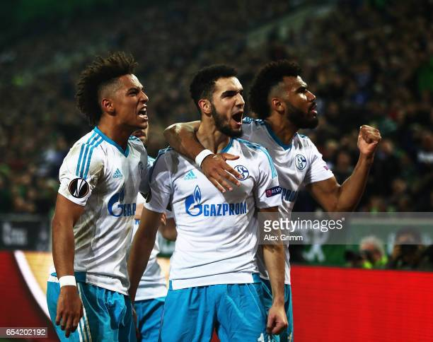 Nabil Bentaleb of Schalke 04 celebrates after scoring a penalty goal during the UEFA Europa League Round of 16 second leg match between Borussia...